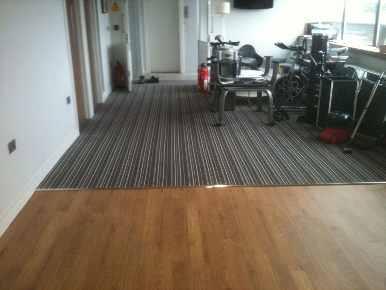 Floor installation services commercial flooring services for Rubber laminate flooring
